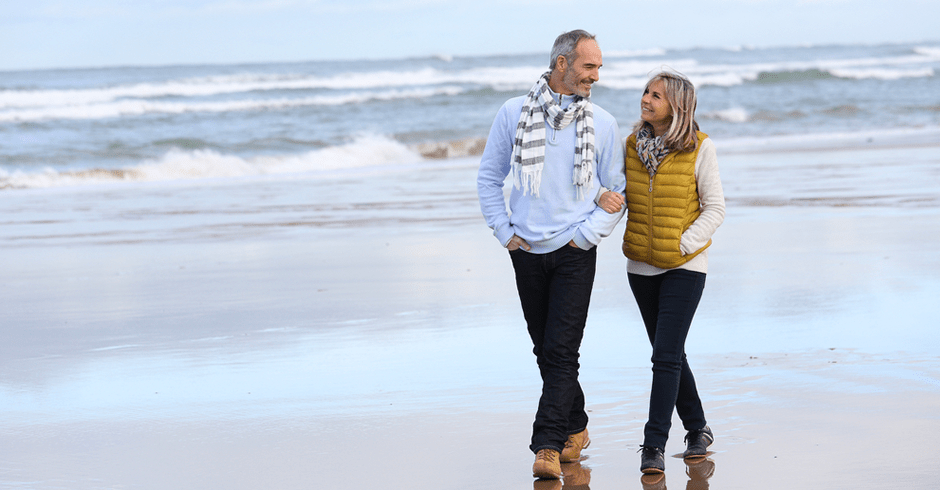 Couple walking along sea shore