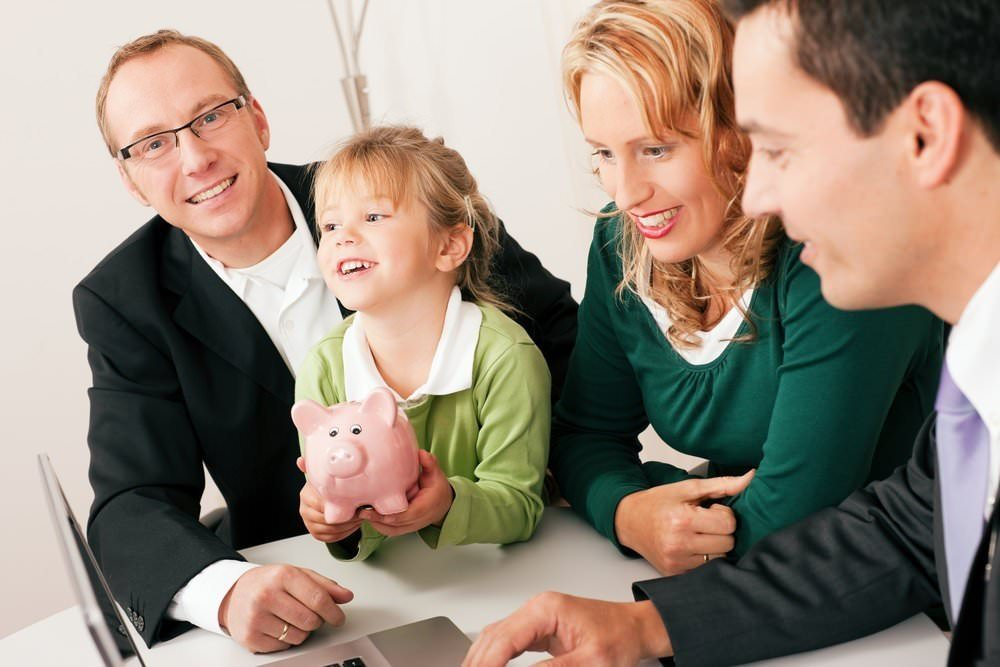 Inheritance Tax - Family with child holding a piggy bank