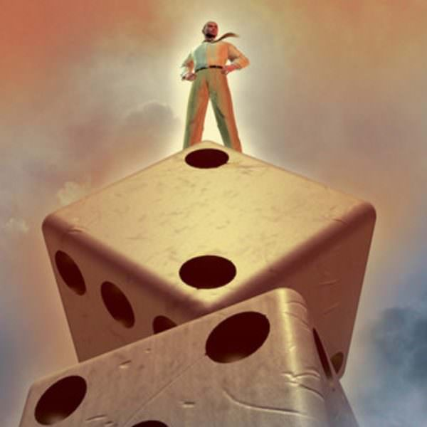 Person on top of giant dice